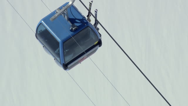 ws aerial view of cable car at jacobshorn ski station / switzerland - overhead cable car stock videos & royalty-free footage