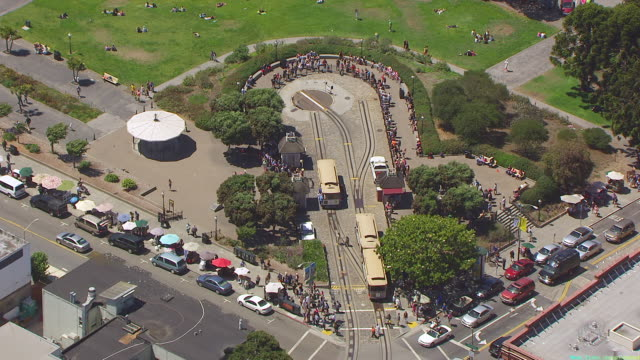 WS AERIAL POV View of Cable car turntable and car moving along street at Lombard Street / San Francisco, California, United States