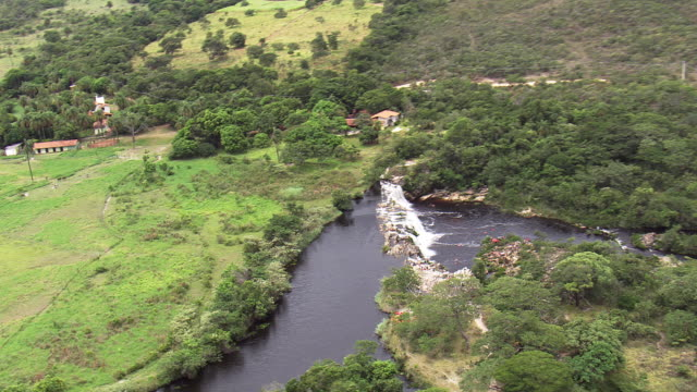 ws aerial ds view of cachoeira grande waterfall / minas gerais, brazil - cachoeira stock videos and b-roll footage