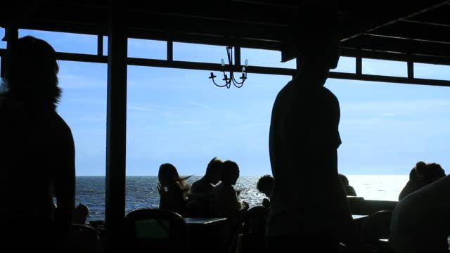 ws view of cafe by sea / shonan, kanagawa, japan - 神奈川県点の映像素材/bロール