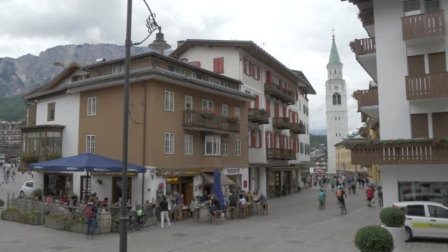 view of cafes and parrocchiale ss filippo e giacomo in cortina d'ampezzo, belluno, dolomites, italy, europe - 18th century stock videos and b-roll footage