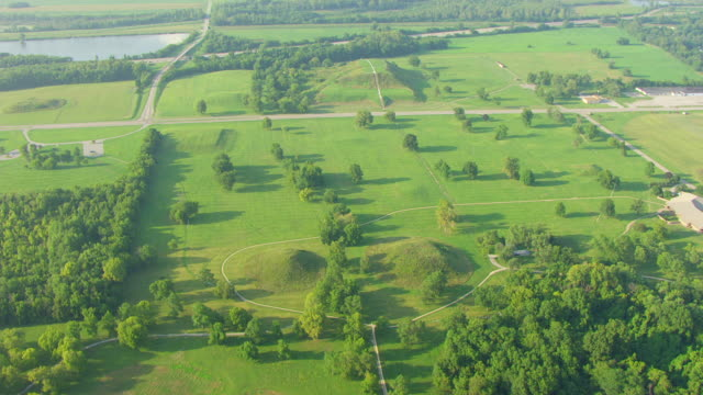 WS AERIAL POV View of Cahokia Mounds State Historic Site with large landscape / Collinsville, Illinois, United States