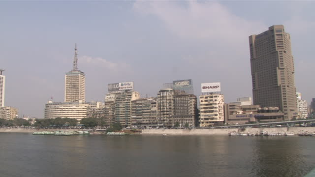ws pan view of cairo skyline over river  / cairo, egypt - egypt stock videos & royalty-free footage