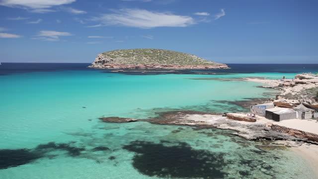 ws view of cala comte and illa des bosc / ibiza, balearic islands, spain  - イビサ島点の映像素材/bロール