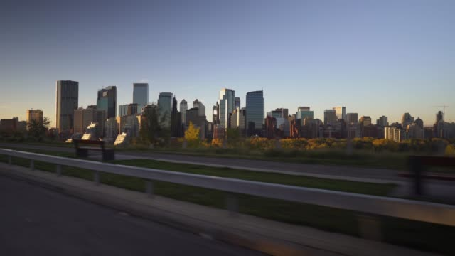 view of calgary skyline in the morning while driving - calgary stock videos & royalty-free footage