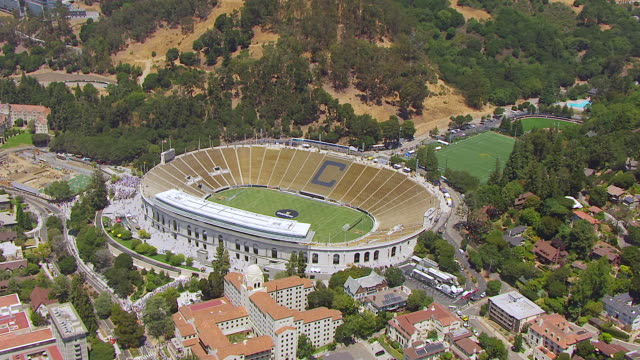 WS AERIAL POV View of California Memorial Stadium and town and people lined up outside of stadium / Berkeley, California, United States