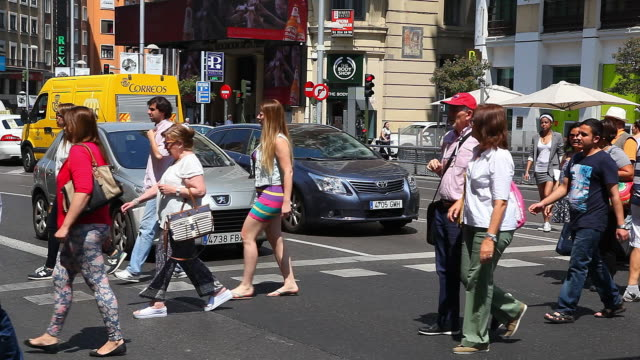 view of callao square and gran via one of the main streets and most famous landmarks of madrid in spain on june 8 2015 - pedestrian crossing stock videos & royalty-free footage