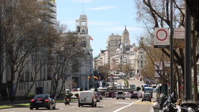 view of calle de alcala towards plaza cibeles in bright sunshine, madrid, spain, europe - lockdown stock videos & royalty-free footage