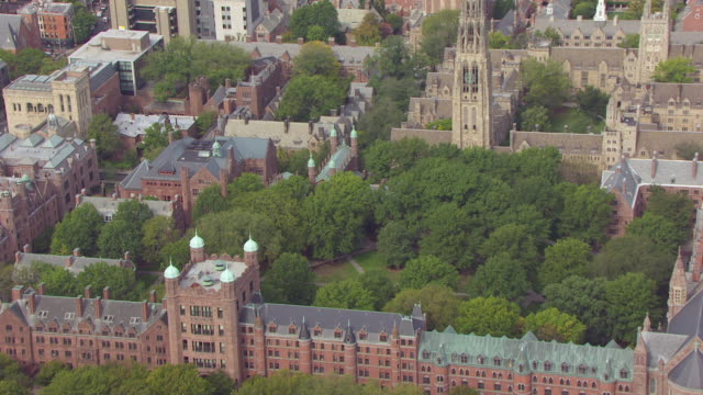 WS AERIAL POV ZO View of campus surrounding Yale School of Drama building and University Theatre in city / New Haven, Connecticut, United States