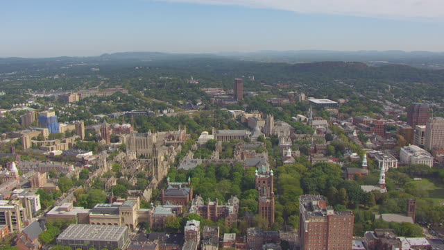 ws aerial pov view of campus surrounding yale school of drama building and university theatre in city / new haven, connecticut, united states - new haven stock-videos und b-roll-filmmaterial