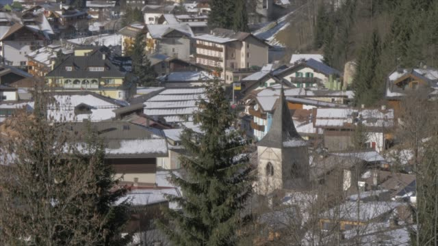view of canazei town on sunny day in winter, province of trento, italian dolomites, italy, europe - canazei video stock e b–roll