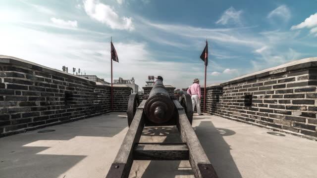 ms t/l view of cannon beside janganmun gate in suwon hwaseong castle (unesco world heritage)   / suwon, gyeonggi do, south korea - hwaseong palace stock videos and b-roll footage