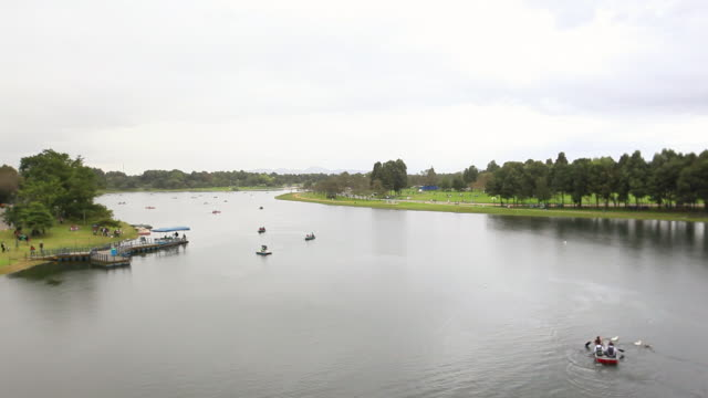 WS HA View of canoes and paddle boats in lake inside a park / Bogota, Colombia