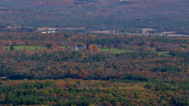 ms aerial view of canterbury shaker village surrounded by autumn trees / new hampshire, united states - new hampshire stock-videos und b-roll-filmmaterial