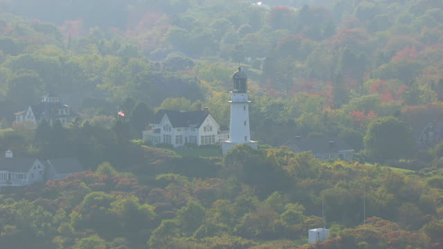 WS AERIAL POV View of Cape Elizabeth Lighthouse with forest area / Cape Elizabeth, York County, Maine, United States