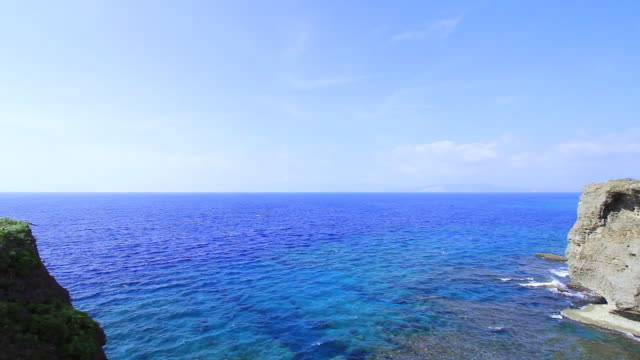 ws tu view of cape manza and beach / onna, okinawa, japan - ティルト点の映像素材/bロール