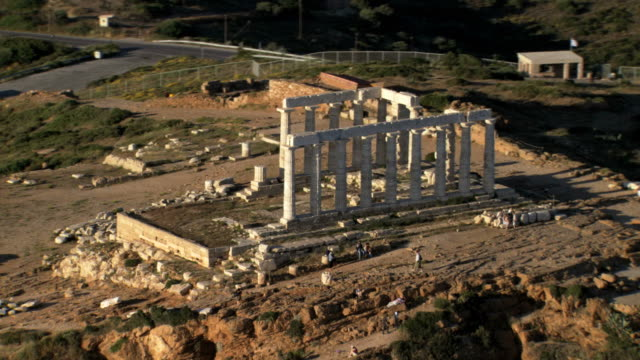 ws aerial ds view of cape sounio in athens ,athens, greece an ancient greek temple of poseidon / athens, greece - sounion stock videos and b-roll footage