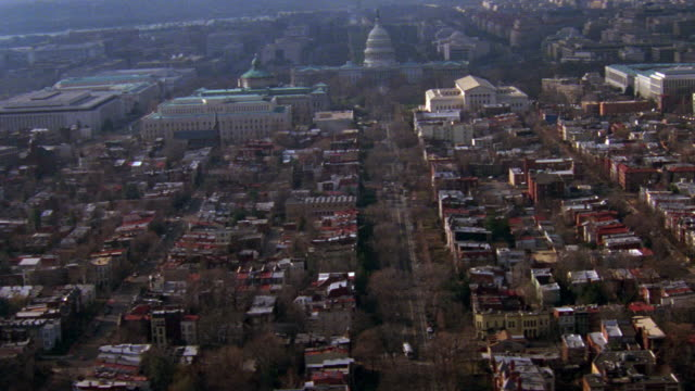 vídeos de stock, filmes e b-roll de ws aerial view of capitol building and city / washington d.c., united states - 1996