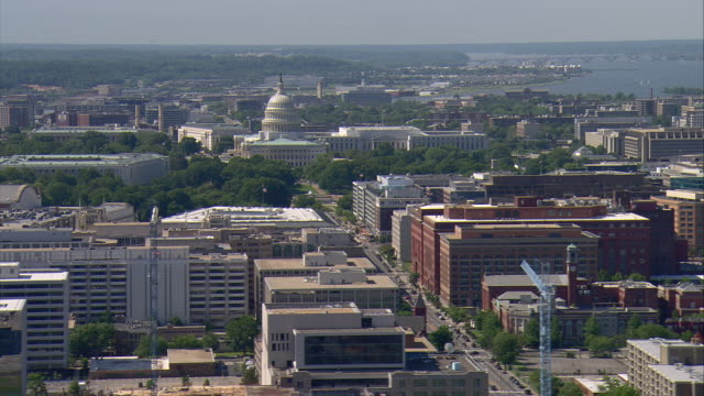 WS AERIAL View of Capitol Building and city with Potomac River / Washington, Dist. of Columbia, United States