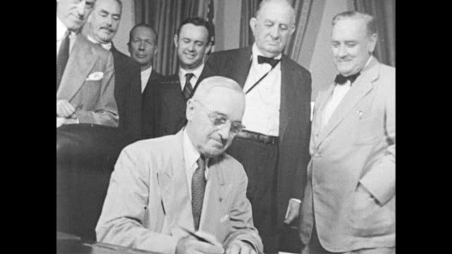 stockvideo's en b-roll-footage met / view of capitol building / inside congress / president roosevelt signs social security act into law on august 14 1935 / president harry truman... - 1956