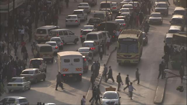 ws ha view of car and bus traffic on street / nairobi, nairobi province, kenya  - ナイロビ点の映像素材/bロール
