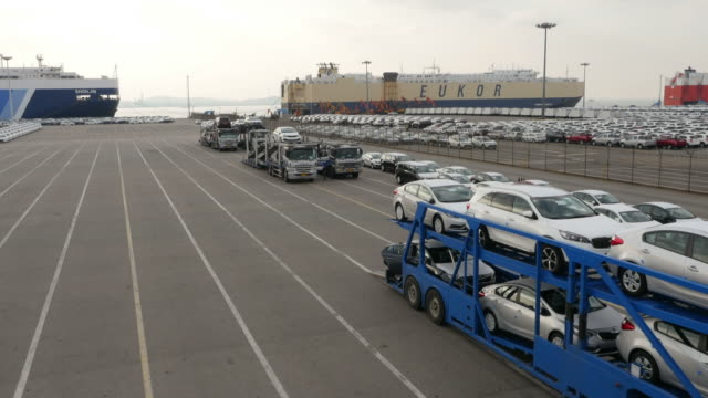View of Car carrier trailers parking in a row near export pier of Pyeongtaek port