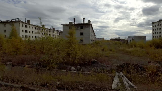 view of car drive in the ghost town of kadykchan,magadan,russia. - russland stock-videos und b-roll-filmmaterial