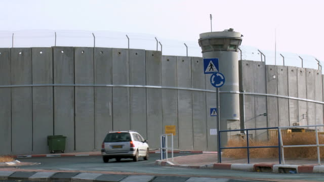 ws view of car driving by israeli west bank wall at beit lehem area / jerusalem, judea, israel - west bank stock videos & royalty-free footage