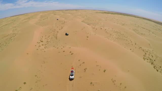 WS AERIAL View of Car driving in Tengger Desert/Alashan, Inner Mongolia, China.