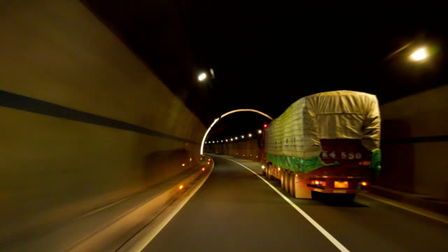 view of car driving in tunnel,china. - pierced stock videos & royalty-free footage