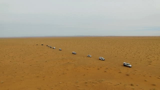 aerial view of car driving on gobi desert/inner mongolia, china. - 4x4 stock videos & royalty-free footage