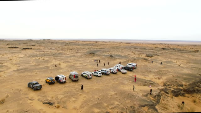 AERIAL View of car driving on gobi desert/Inner Mongolia, China.
