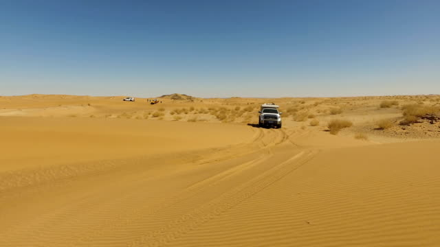 view of car driving on gobi desert/inner mongolia, china. - schotterstrecke stock-videos und b-roll-filmmaterial