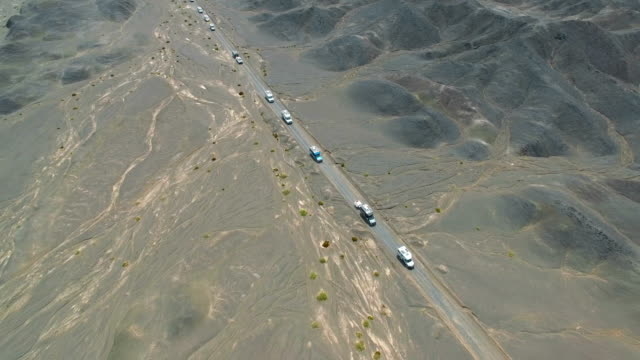 aerial view of car driving on gobi desert,xinjiang, china. - convoy stock videos & royalty-free footage