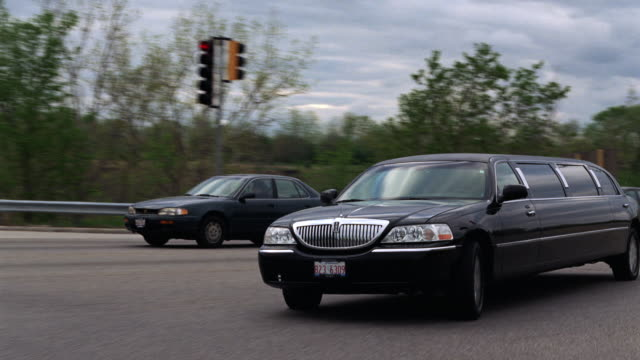 ws pov view of car driving on highway / chicago, illinois, united states - limousine stock videos & royalty-free footage