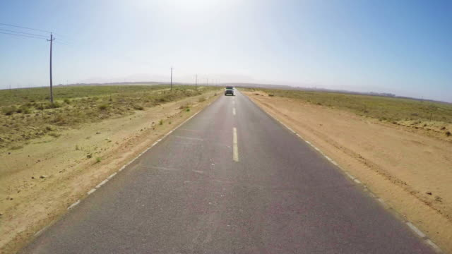 pov view of car driving on road in gobi desert/alashan, inner mongolia, china. - telegraph pole stock videos and b-roll footage