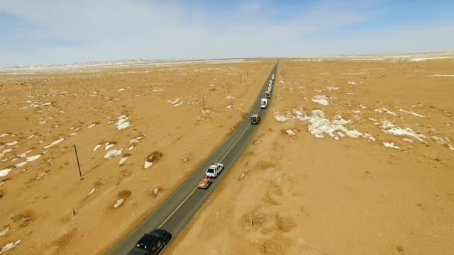 View of car driving on road through gobi desert/Inner Mongolia, China.