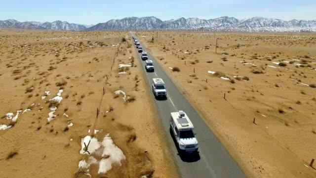 view of car driving on road through gobi desert/inner mongolia, china. - 繰り返し点の映像素材/bロール