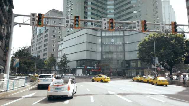 view of car driving on road,chongqing,china. - road sign stock videos & royalty-free footage