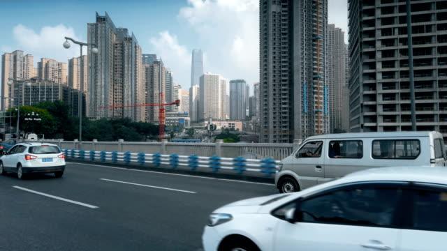 view of car driving on road,chongqing,china. - 方向標識点の映像素材/bロール