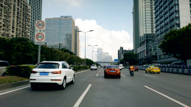view of car driving on road,chongqing,china. - asphalt stock-videos und b-roll-filmmaterial