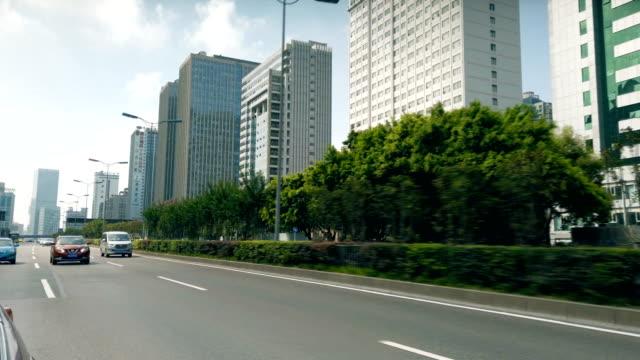 vidéos et rushes de view of car driving on road,chongqing,china. - vue subjective d'une voiture