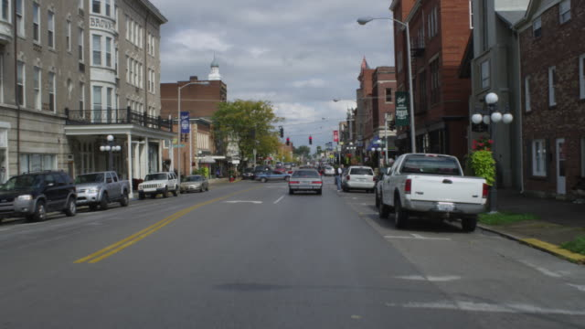 ws pov view of car driving through small town / winchester, kentucky, united states - road signal stock videos & royalty-free footage