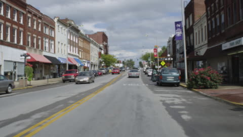 ws pov view of car driving through small town / winchester, kentucky, united states - small town america stock videos & royalty-free footage