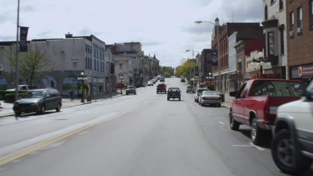 ws pov view of car driving through small town / winchester, kentucky, united states - small town stock videos & royalty-free footage