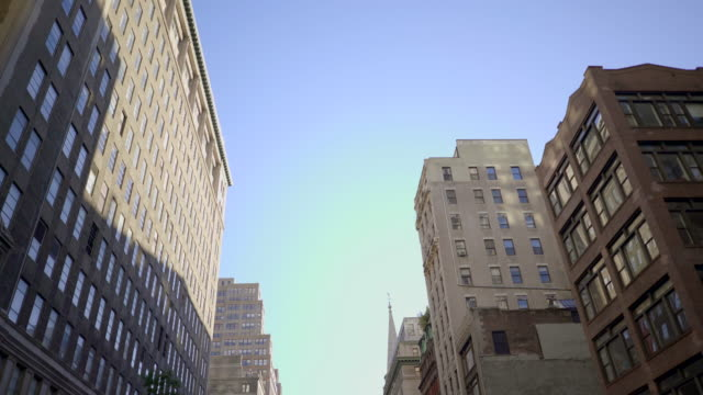 POV view of car driving trough city streets. new york architecture background