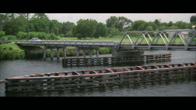 ws pan view of car moving from drawbridge / florida, usa - drawbridge stock videos and b-roll footage
