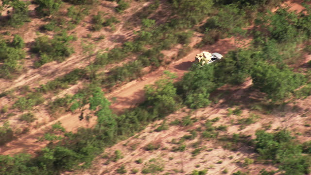 ws aerial ts view of car moving on dirt road / minas gerais, brazil - minas stock videos and b-roll footage