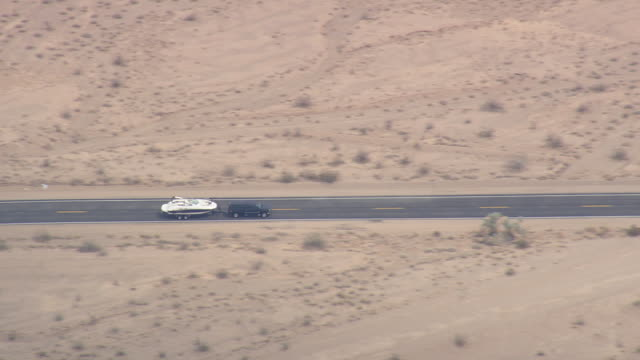 WS AERIAL ZI ZO TS View of Car on Desert Centre Rice Road / Arizona, United States