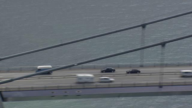 WS AERIAL TS View of car on Great belt bridge / Fyn, Denmark
